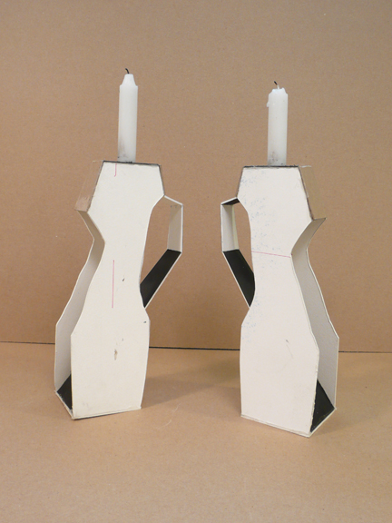 Dawn Cerny, Candle Holders, 2012, paper construction with candles, 9 x 4 x 2 inches each.