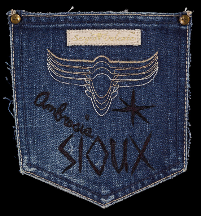 Allison Manch, AMBROSIA SIOUX, 2011, ink and embroidery on blue jean pocket, 6.5 x 6 inches.